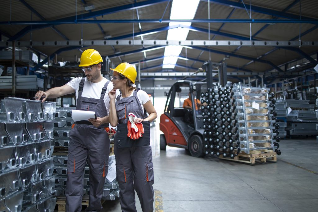 Factory workers checking quality products industrial warehouse scaled